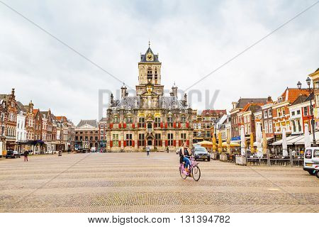 Delft, Netherlands - April 8, 2016: Stadhuis or City Hall at Markt square, houses, people in Delft, Holland