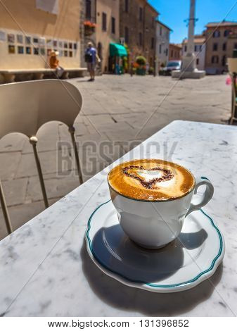Cup Of Cappucino In An Italian Town.