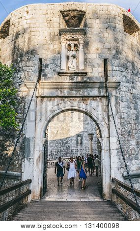Dubrovnik, Croatia - 26th August 2015. Tourists passes Pile Gate - main entry to Old Town of Dubrovnik city