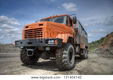 Poltava Region Ukraine - June 26 2010: Mining crew bus parked near the road on the iron ore opencast