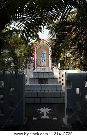 KUMROKHALI, INDIA - FEBRUARY 13: The tomb of the Croatian Jesuit missionary Ante Gabric behind the Catholic Church in Kumrokhali, West Bengal, India February 13, 2014.