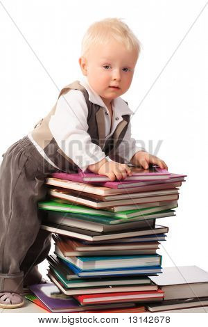 Portrait of a pretty boy with books.