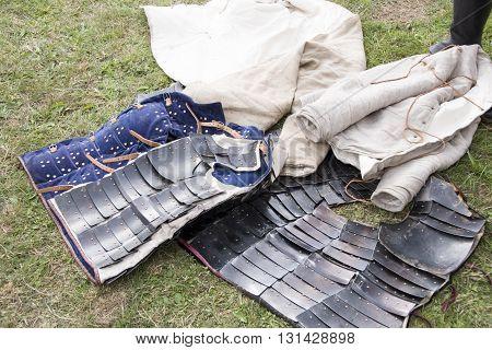 Tewkesbury, UK-July 17, 2015: Plated metal armour & jerkin in living history camp on 17 July 2015 at Tewkesbury Medieval Festival