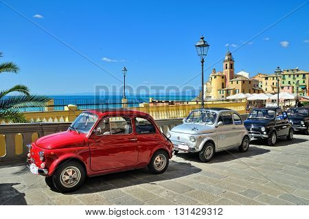 Camogli Liguria Italy - September 20 2015 Festival Fiat 500 Rally takes place on the beach Camogli Garibaldi Street. Between 11 am and 12:30 the participants created a tour of the city east. Is a symbol of Italian design and legendary country. Fiat 500 Nu