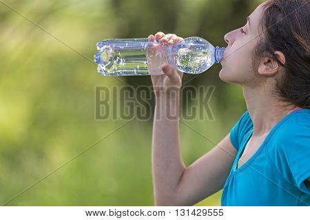 Caucasian jogger woman thirsty after sports outdoor