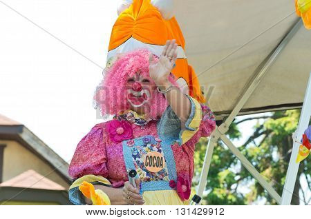 WEST ST. PAUL, MINNESOTA - MAY 21, 2016: Colorful clown with water sprayer waves to crowd during annual West St. Paul Days Grande Parade in West St. Paul on May 21, 2016.