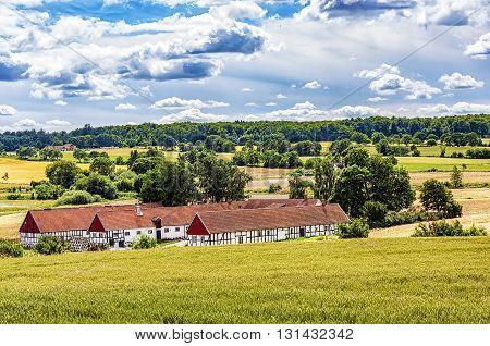 Image of a traditional swedish famrhouse. Ravlunda Osterlen.