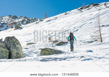 Skier walking on a trail. Ski touring is a winter off-piste sport.