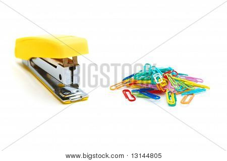 Yellow stapler and colour paperclips