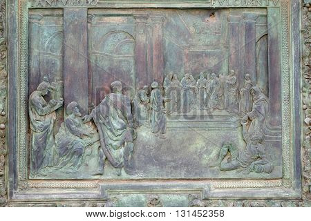 PISA, ITALY - JUNE 06, 2015: Wedding of the Virgin Mary, sculpture work from Giambologna's school, central portal of the Cathedral St. Mary of the Assumption in Pisa, Italy on June 06, 2015