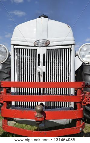 ROLLAG, MN, SEPT 3, 2015: A restoration of anold Ford tractor with grill guards  is on display at the West Central Steam Threshers Reunion (WCSTR) which occurs every Labor Day with 1,000's in attendance