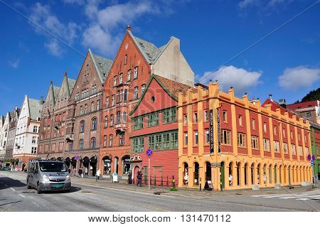 BERGEN NORWAY - SEPTEMBER 26 2013: Pedestrians and a car passing by the historical Hanseatic Museum in Bergen city. The Hanseatic Museum is one of the oldest wooden buildings in Bergen.