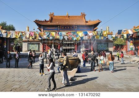 HOHHOT CHINA - OCTOBER 1 2012: Tourists in front of the Da Zhao Temple the temple is a Buddhist monastery and the largest temple in the city of Hohhot.
