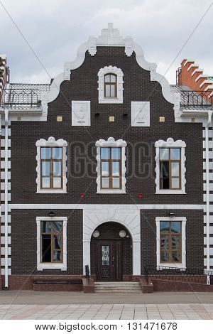 Beautiful brown house on Bryggen. The Republic of Mari El Yoshkar-Ola Russia. 05/21/2016