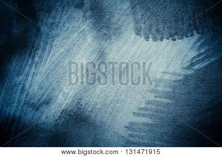 Textured navy blue background. Blue abstract brushed surface. Grungy painted wall. Old paint with cracks texture blue. Aged street wall. Vintage effect.