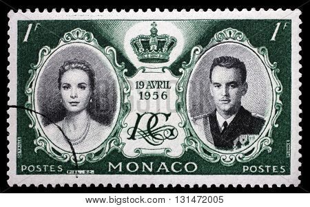 ZAGREB, CROATIA - JULY 03: Green color stamp printed in Monaco with portrait of Grace Kelly and Prince Rainier to commemorate their marriage, circa 1956, on July 03, 2014, Zagreb, Croatia