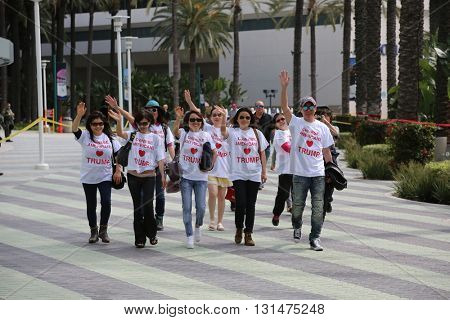 ANAHEIM CALIFORNIA, May 25, 2016: Chinese American Supporters, wave signs and show their support for Presidential Candidate Donald J. Trump at the Anaheim Convention Center rally on.  5.25.2016