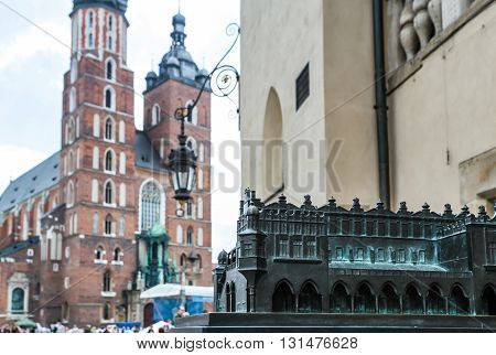 Krakow, Poland- May 25, 2016: Small copy of Church of Our Lady Assumed into Heaven. Is a Brick Gothic church re-built in the 14th century. With tourists on square