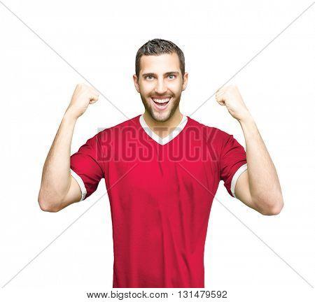 Athlete wearing red uniform celebrating on white background