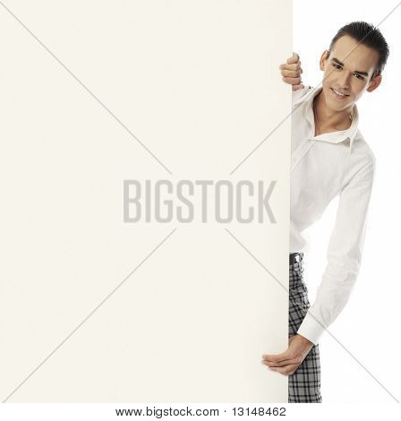 Portrait of a handsome young man holding a billboard. Shot in a studio.