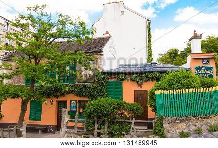 Paris; France-May 25 2016 : The artistic Montmartre cabaret Au Lapin agile became a favorite spot for struggling artists and writers including Picasso Modigliani Apollinaire and Utrillo.