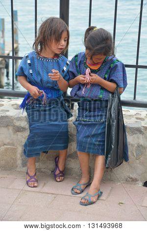 SANTA CATARINA PALOPO DE ATITLAN GUATEMALA NAY 01 2016: Portrait of a Mayan child in blue huipil. The Mayan people still make up a majority of the population in Guatemala,