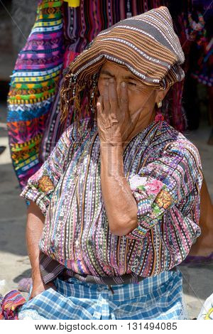 CHICHICASTENANGO GUSTEMALA APRIL 29 2016: Portrait of a Mayan women saling table cloth. The Mayan people still make up a majority of the population in Guatemala,