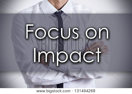 Focus On Impact - Young Businessman With Text - Business Concept