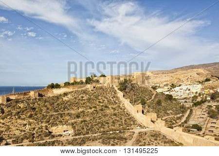 The moorish fortress Alcazaba at Almeria, with  the colorful La Chanca neighborhood in background