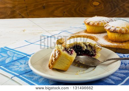 Confiture dessert on the white plate. Sweet dessert. Sweet pastry. Small pie. Pie. Jam pie