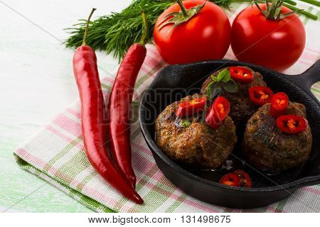Grilled meatballs with chili pepper. Meatloaf. Meatballs.Grilled meatballs. Turkish meatball. Fresh vegetables. Chili pepper.