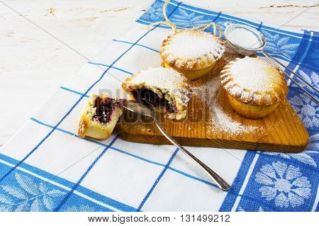 Small sweet pie on the cutting board. Sweet dessert. Sweet pastry. Jam pie Small pie. Pie. Sweet pie.