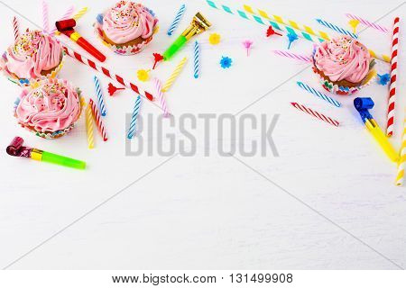 Birthday background with pink cupcakes and candles. Birthday cupcakes. Gourmet cupcakes. Sweet dessert. Sweet pastry. Birthday invitation. Birthday mockup. Styled desktop. Birthday background.