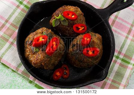Grilled meatballs with chili pepper slices. Meatloaf. Meatballs.Grilled meatballs.