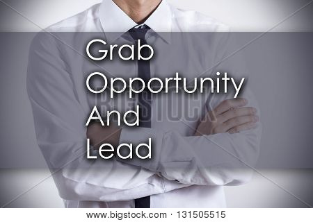 Grab Opportunity And Lead Goal - Young Businessman With Text - Business Concept