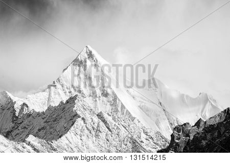 Mountain peak in monotone with snow cover