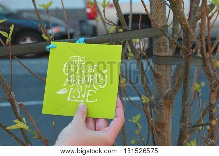 Philadelphia, USA - April 26, 2016: Hand holding paper note with text