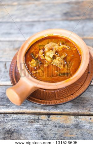Panang pork curry Thailand famous food on wood table