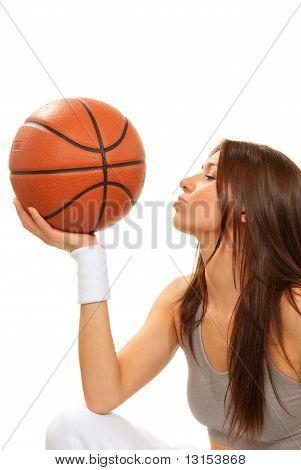 Basketball Brunette Woman Player Kissing Ball