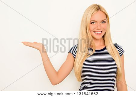 Portrait Of Happy Cute Young Woman Showing Product