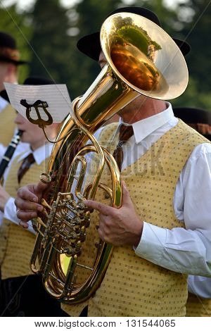 Musicians in costume plays baritone a form of Tenor Horns