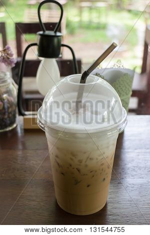 Iced coffee take away glass on wooden table stock photo