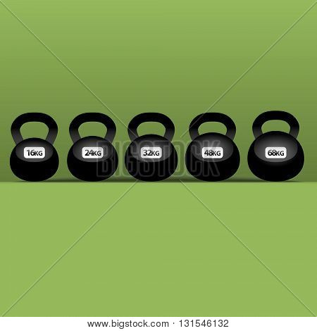 set of six black kettlebells on green background