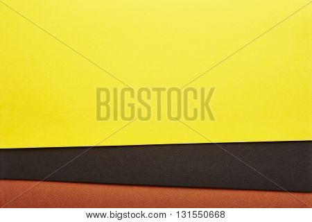 Colored cardboards background in yelow black brown tone. Copy space. Horizontal