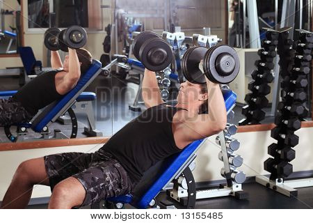Sporty man in the gym centre.