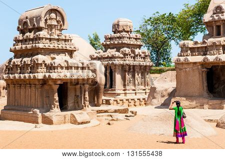 Tourist taking a picture at Pancha ratha temples in Mammallapuram India