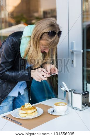 Woman Taking Picture Of Her Coffee Shop Breakfast