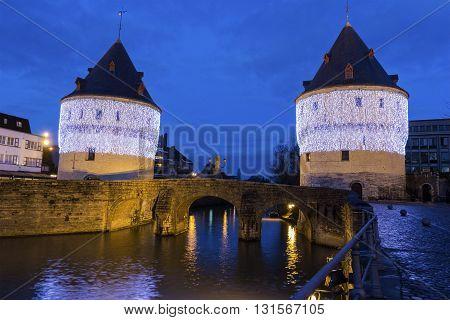 Broel Towers along the river Lys during Christmas in Kortrijk in Belgium