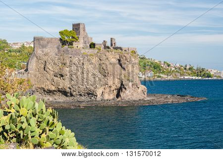 The norman castle of Acicastello near Catania built on a lava cliff on the sea