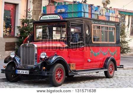 ROTHENBURG OB DER TAUBER, GERMANY - JANUARY 04, 2012: Vintage car in front of the Kathe Wohlfahrts German Christmas Museum